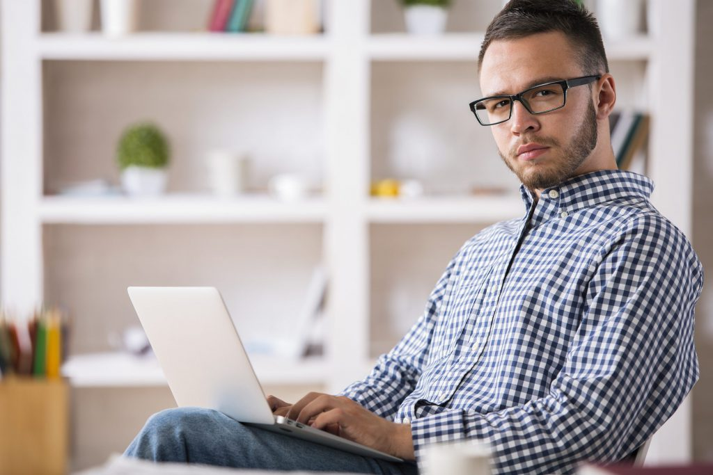 Caucasian male using laptop